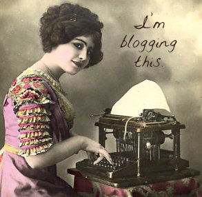 vintage woman at typewriter I'm blogging this